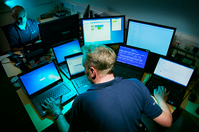 IT Technician using several computers