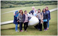 Sir Roger Bone, president of Boeing UK, with 7 of the gliding scholars