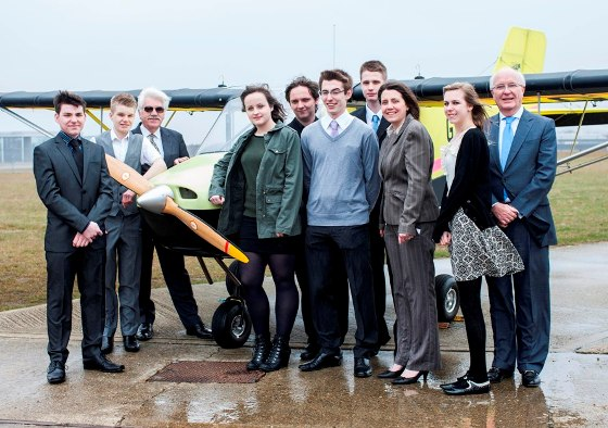 Students from Yateley School plus Lee Balthazor from the RAeS (3rd left) and Sir Roger Bone, president Boeing UK (right) with G-YTLY